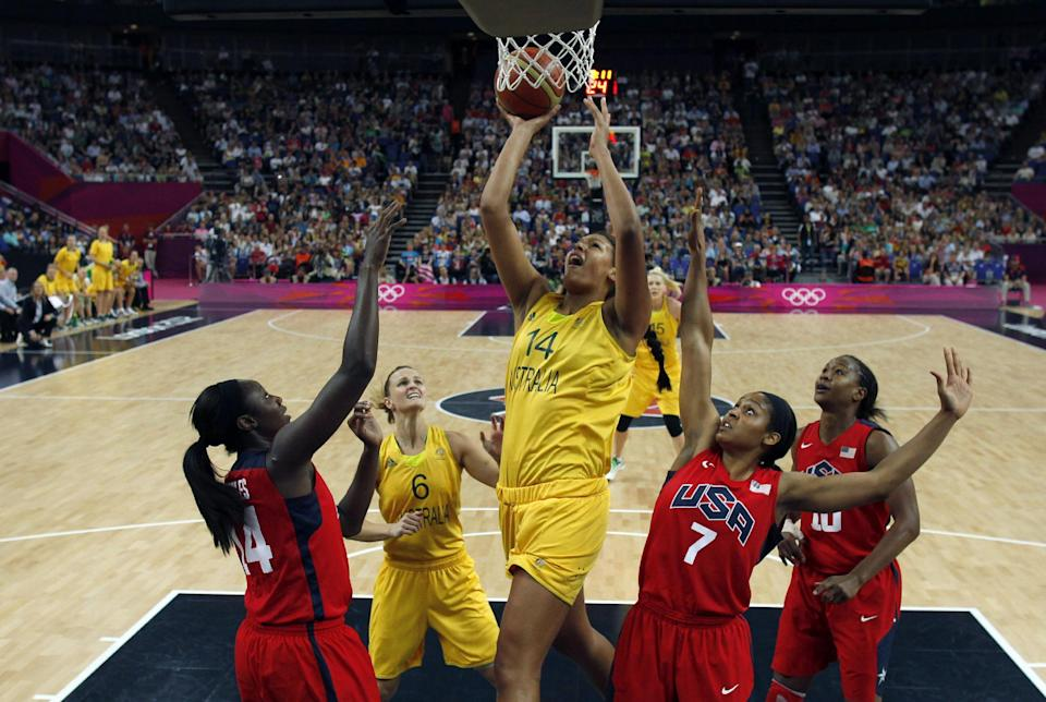 Australia's Liz Cambage, center, shoots over United States' Maya Moore, right, and Tina Charles during their women's basketball semifinal match at the 2012 Summer Olympics on Thursday, Aug. 9, 2012, in London. (AP Photo/Sergio Perez, Pool)
