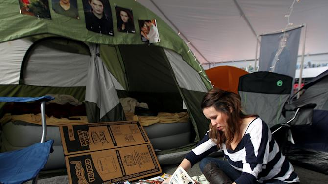 """Heather Hagan, of East Lansing, Mich., makes a poster inside the Twilight fan camp ahead of the world premiere of """"The Twilight Saga: Breaking Dawn - Part 2"""" on Friday, Nov. 9, 2012 in Los Angeles. The premiere will be held Nov. 12. (Photo by Matt Sayles/Invision/AP)"""