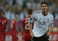 German forward Mario Gomez (R) celebrates after scoring a goal during their Euro 2012 championships Group B match against Portugal, on June 9, at the Arena Lviv. Germany won 1-0