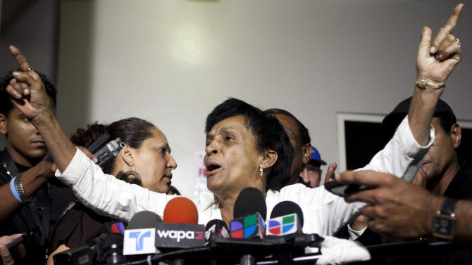 "Maria Matias, mother of former world boxing champion Hector ""Macho"" Camacho, speaks with reporters outside Centro Medico trauma center in San Juan, Puerto Rico, Friday, Nov. 23, 2012. Camacho, who has been unconscious since he was shot in the face last Tuesday and declared brain dead by doctors, will be taken off life support on Saturday, his mother said in the brief news conference, a decision that the former championship boxer's eldest son opposes. (AP Photo/Dennis M. Rivera Pichardo)"