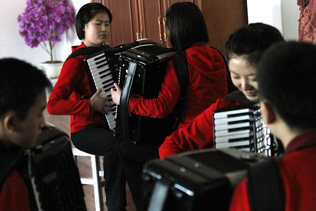 In this Feb. 25, 2012 photo, students rehearse with accordions in a practice room at the Kumsong school in Pyongyang, North Korea. A group from the school became an Internet sensation with their accordion version of 1980&#39;s pop group A-ha&#39;s &quot;Take on Me.&quot; (AP Photo/Kim Kwang Hyon)