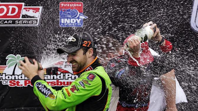 Winner James Hinchcliffe, left, of Canada, douses third-place finisher Marco Andretti as they celebrate after the IndyCar Series Honda Grand Prix of St. Petersburg auto race, Sunday, March 24, 2013, in St. Petersburg, Fla. (AP Photo/Chris O'Meara)