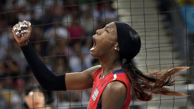 USA's Destinee Hooker (19) reacts after scoring a point against South Korea during a women's volleyball semifinal match at the 2012 Summer Olympics Thursday, Aug. 9, 2012, in London. (AP Photo/Chris O'Meara)