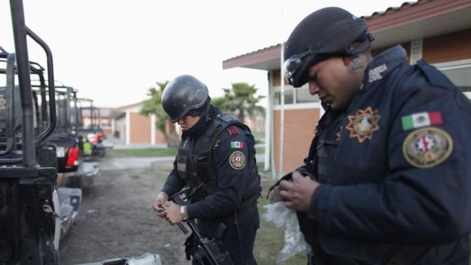 Members of the Fuerza Civil police unit load their weapons before going on patrol at their headquarters in Monterrey