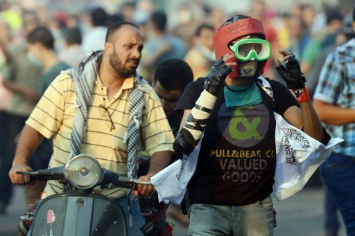 An Egyptian protester wears a makeshift mask and helmet for protection during clashes with riot police near the US embassy in Cairo on September 13. The US boosted security at its embassies amid fears that more anti-American violence sparked by a film mocking Islam could erupt after Friday's Muslim prayers across the Middle East and North Africa
