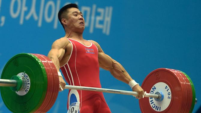 North Korea's Kim Un-Guk competes in the men's 62kg weightlifting event at the Asian Games in Incheon on September 21, 2014