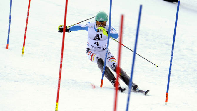 Germany's Felix Neureuther competes on his way to take second place, during an alpine ski, men's World Cup slalom in Kitzbuehel, Austria, Sunday, Jan. 27, 2013. (AP Photo/Giovanni Auletta)