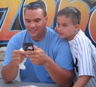Babe Ruth baseball coach John Zahradnik with his son — Facebook