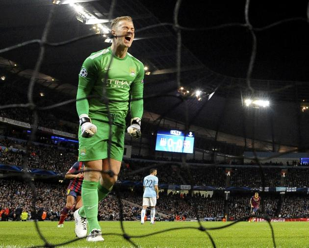 Manchester City's goalkeeper Joe Hart reacts after Barcelona's Lionel Messi scored a penalty during their Champions League round of 16 first leg soccer match at the Etihad Stadium in Mancheste