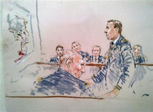 A courtroom sketch shows prosecutor Lieutenant Colonel …