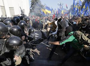 Police clash with  demonstrators outside parliament…