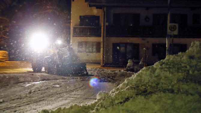 A resident of the southern German village of Warngau uses an excavator to shovel snow after heavy snowfall