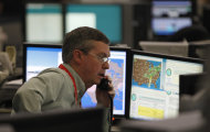 FILE - In this January 26, 2012, file photo, shows the flight control center at American Airlines headquarters in Fort Worth, Texas. Travel in the Northeast creaked back into motion on Wednesday, a grinding, patchy recovery that made it clear that stranded travelers will struggle to get around for days to come. (AP Photo/LM Otero)