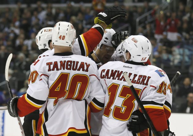 Calgary Flames' Mike Cammalleri celebrates with teammates after scoring against the Los Angeles Kings during the first period of their NHL hockey game in Los Angeles
