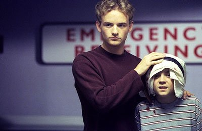 "Francis (Christopher Masterson, L) takes a reluctant Malcolm (Frankie Muniz, R) to the emergency room in the ""Home Alone 4"" episode of Fox's Malcolm In The Middle"