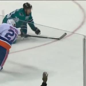 Kyle Okposo strikes off the faceoff on Niemi