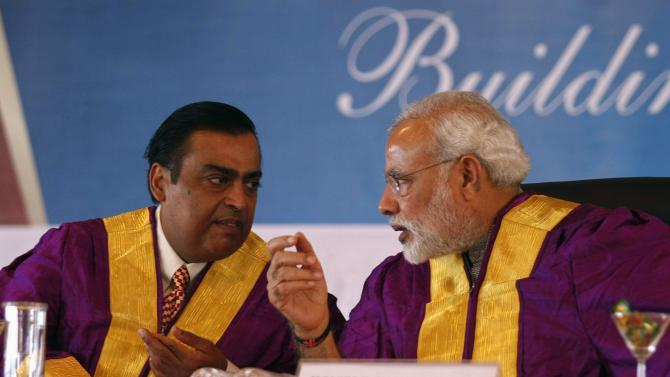 Gujarat's chief minister Modi speaks with Ambani chairman of Reliance Industries Ltd., during a convocation ceremony at PDP at Gandhinagar