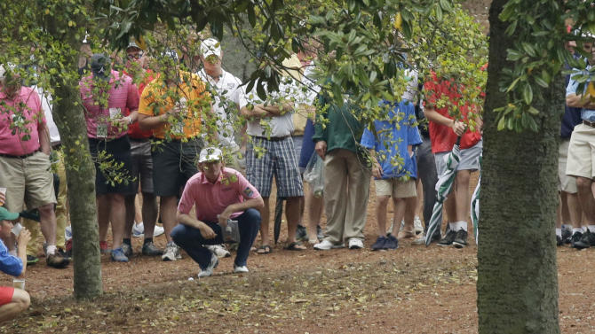 Brandt Snedeker studies his shot before hitting out of the rough off the 10th fairway during the fourth round of the Masters golf tournament Sunday, April 14, 2013, in Augusta, Ga. (AP Photo/David J. Phillip)