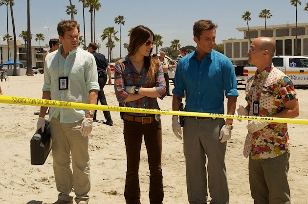 "Michael C. Hall as Dexter, Jennifer Carpenter as Debora Morgan, Desmond Harrington as Joey Quinn, and C.S. Lee as Vince Masuka in ""Dexter."""