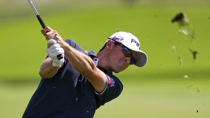 Scott Langley follows his shot off the first fairway during the third round of the Sony Open golf tournament on Saturday Jan. 12, 2013, in Honolulu.  (AP Photo/Marco Garcia)