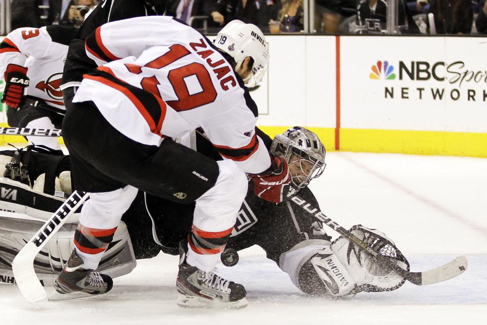Los Angeles Kings goalie Jonathan Quick stops a shot on the goal by New Jersey Devils' Travis Zajac (19) in the third period during Game 4 of the NHL hockey Stanley Cup finals, Wednesday, June 6, 2012, in Los Angeles. The Devils won the game 3-1. (AP Photo/Julie Jacobson)