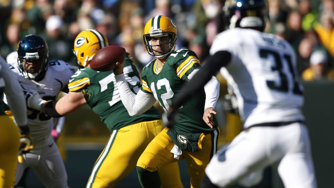 Green Bay Packers quarterback Aaron Rodgers (12) makes a pass against the Jacksonville Jaguars during the second half of an NFL football game, Sunday, Oct. 28, 2012, in Green Bay, Wis. (AP Photo/Tom Lynn)