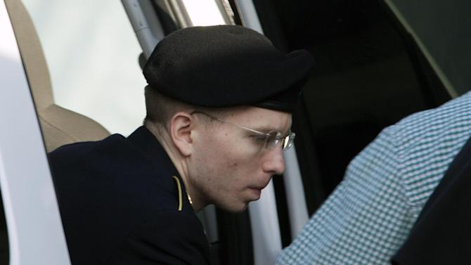 Army Pfc. Bradley Manning arrives at the courthouse in Fort Meade, Md., Monday, July 8, 2013, after the start of the sixth week of his court martial. Manning is charged with indirectly aiding the enemy by sending troves of classified material to WikiLeaks. He faces up to life in prison. ( AP Photo/Jose Luis Magana)