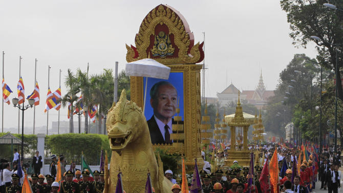 The portrait of late former King Norodom Sihanouk leads his royal funeral procession ahead of his Feb. 4, cremation Friday, Feb. 1, 2013, in Phnom Penh, Cambodia. (AP Photo/Heng Sinith)