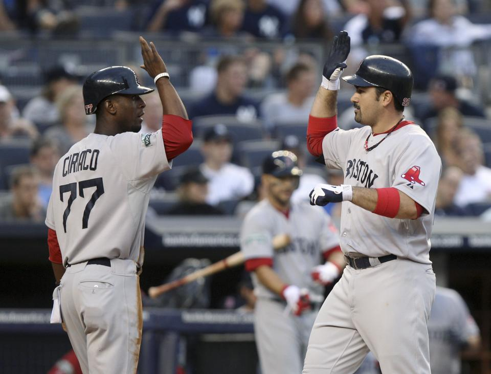 Boston Red Sox's Adrian Gonzalez, right, is greeted by Pedro Ciriaco after hitting a three-run home run during the fifth inning of the baseball game against the New York Yankees at Yankee Stadium in New York, Saturday, July 28, 2012. (AP Photo/Seth Wenig)