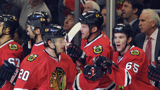 Chicago Blackhawks' Brandon Saad (20) is congratulated by Andrew Shaw after scoring a goal against the Nashville Predators during the first period of an NHL hockey game Friday, April 19, 2013, in Chicago. (AP Photo/Jim Prisching)