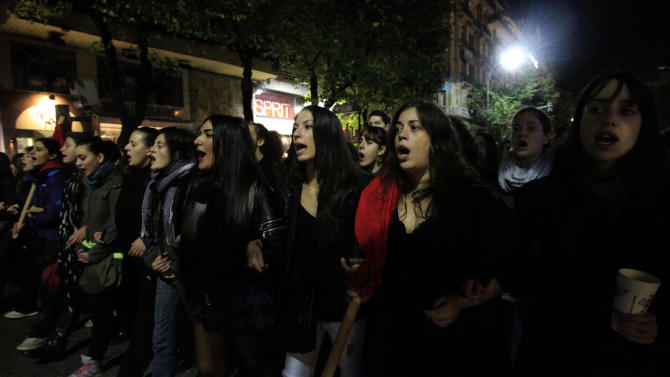 Protesters chant slogans during a protest commemorating the student uprising against a military dictatorship in 1973, at the northern city of Thessaloniki  Greece, Sat. Nov. 17 2012. In the northern Greek city of Thessaloniki, Greece's second-largest city, about 12,000 people marched, police said. Some burned a European Union flag, angry over EU demands to cut Greek spending in order to get a desperately needed bailout loan. (AP Photo/Nikolas Giakoumidis)