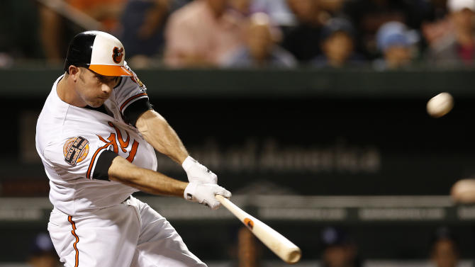 Baltimore Orioles' J.J. Hardy hits a two-run home run in the third inning of a baseball game against the Tampa Bay Rays in Baltimore, Tuesday, Sept. 11, 2012. (AP Photo/Patrick Semansky)