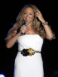 "FILE - This June 2, 2012 file photo shows American singer Mariah Carey performing during a concert in Monaco. Carey will be joining the cast of ""American Idol."" She told a meeting of the Television Critics Association that she is excited to join as a judge and it all happened quickly. (AP Photo/Lionel Cironneau, file)"