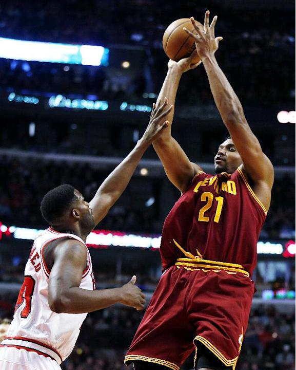 In this Dec. 21, 2013, file photo, Cleveland Cavaliers' Andrew Bynum (21) shoots over Chicago Bulls center Nazr Mohammed (48) during the first half of an NBA basketball game in Chicago. More than