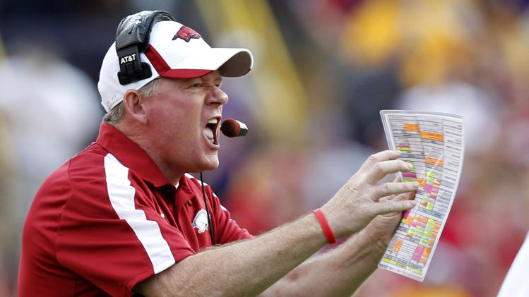 FILE - This Nov. 25, 2011 file photo shows then Arkansas head coach Bobby Petrino calling out to his team during the second quarter of an NCAA college football game against LSU in Baton Rouge, La. Western Kentucky has hired Petrino as its new football coach, said a person familiar with the decision. The person said the former Arkansas coach is expected to be introduced at a Monday afternoon, Dec. 10, 2012 news conference. The person spoke to The Associated Press on condition of anonymity because the school has not officially announced Petrino's hiring. (AP Photo/Gerald Herbert, File)
