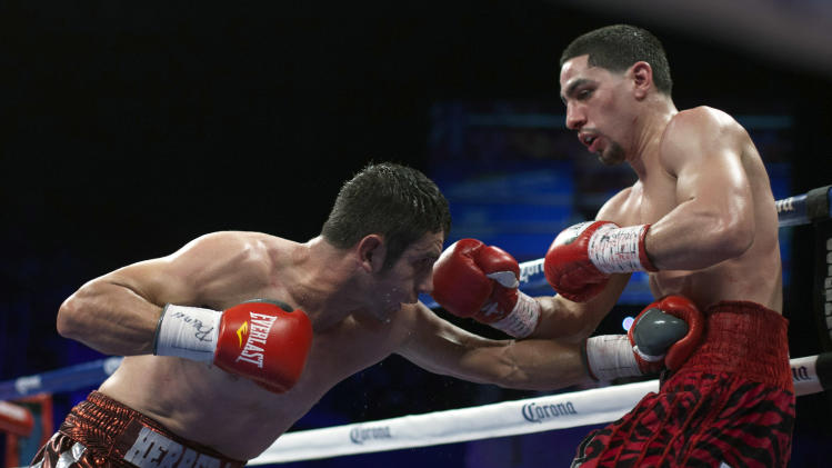 Mauricio Herrera of the U.S. punches WBC unified super lightweight champion Danny Garcia of the U.S. in round eight during their championship fight in Bayamon