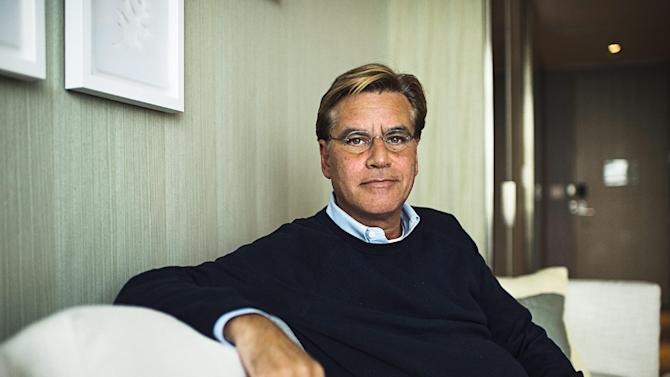 "FILE - In this Oct. 20, 2015 file photo, screenwriter Aaron Sorkin poses for a photo while promoting his movie ""Steve Jobs,"" in Toronto. Harper Lee's classic novel ""To Kill a Mockingbird"" - and it's classic hero Atticus Finch - are heading to Broadway in a new adaptation written by Sorkin. Producer Scott Rudin said the play will make it for the 2017-2018 season, under the direction of Tony Award winner Bartlett Sher, who is represented on Broadway now with ""The King and I"" and ""Fiddler on the Roof."" (Aaron Vincent Elkaim/The Canadian Press via AP, File)"
