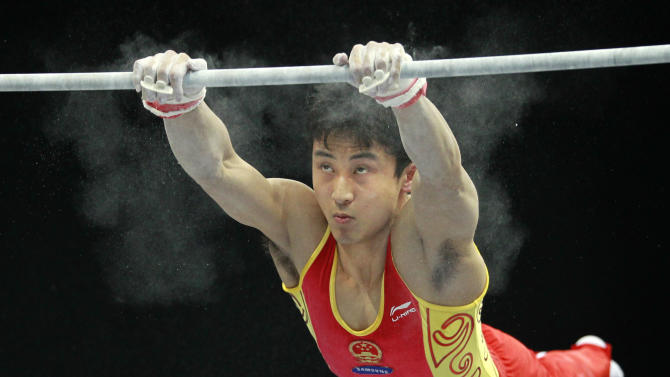 Feng Zhe of China performs on the horizontal bar during the men's qualifying session for the World Gymnastics Championships in Rotterdam, Netherlands, Tuesday Oct. 19, 2010. (AP Photo/Matt Dunham)