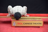 Jackie Chan seals prints at famed Hollywood theater