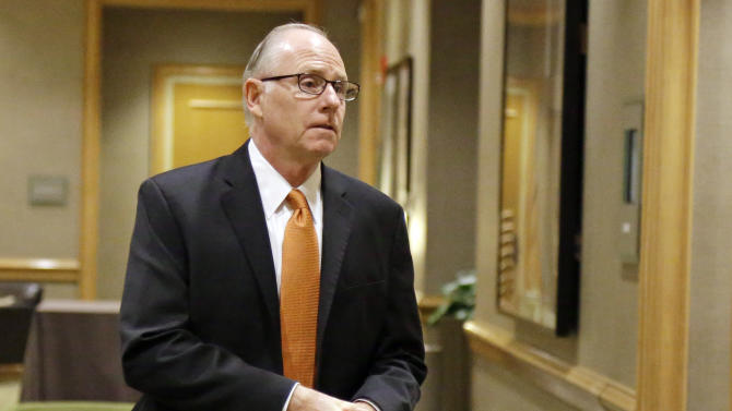 University of Miami basketball coach Jim Larranaga walks to an NCAA Committee on Infractions hearing in Indianapolis, Thursday, June 13, 2013. The committee is scheduled to open its hearings into allegations the University of Miami committed rules infractions in football and men's basketball. (AP Photo/Michael Conroy)