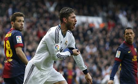 "Real Madrid's Ramos celebrates after scoring a goal during their Spanish first division ""classico"" match against Barcelona in Madrid"