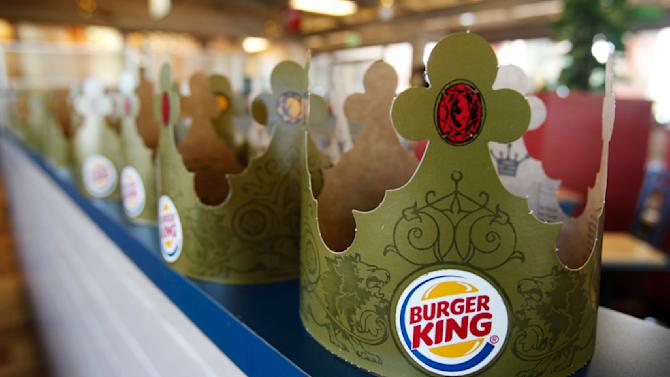 """FILE - In this Aug. 23, 2010, file photo, Burger King crowns are on display in a Mountain View, Calif. store. Burger King said Monday, Oct. 28, 2013, that it saw sales trends in North America turn positive after last month's launch of """"Satisfries,"""" which have 20 percent fewer calories than its regular fries because of a batter that absorbs less oil. (AP Photo/Paul Sakuma, File)"""