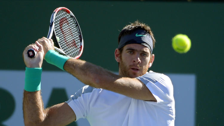 Juan Martin del Potro, of Argentina, returns a shot to Andy Murray, of Great Britain, during their match at the BNP Paribas Open tennis tournament, Friday, March 15, 2013, in Indian Wells, Calif. (AP Photo/Mark J. Terrill)
