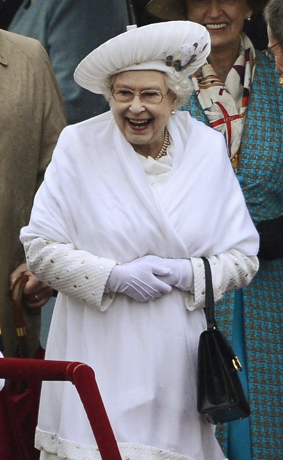 Britain's Queen Elizabeth II smiles during the river pageant commemorating her Diamond Jubilee, on the River Thames in London,  Sunday June 3, 2012. (AP Photo / Dylan Martinez, pool)
