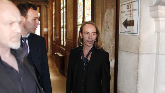 FILE -In this June 22, 2011 file photo, former Dior designer John Galliano arrives at the Paris court house, charged with hurling anti-Semitic slurs in a Paris cafe. Galliano has been invited to return to fashion in the studio of Oscar de la Renta. De la Renta invited Galliano to spend time in his office over the next three weeks, according to a statement released Friday by de la Renta's company. Galliano was dismissed as creative director of Christian Dior and left his own label two years ago after an anti-Semitic rant at a Paris cafe was captured on video. A French court also convicted him on two other complaints of anti-Semitic behavior.  (AP Photo/Thibault Camus, File)