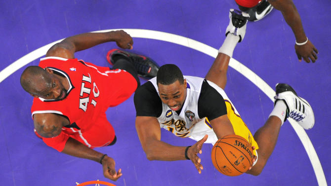 Los Angeles Lakers center Dwight Howard, right, puts up a shot as Atlanta Hawks center Johan Petro, of France, defends during the first half of their NBA basketball game, Sunday, March 3, 2013, in Los Angeles. (AP Photo/Mark J. Terrill)