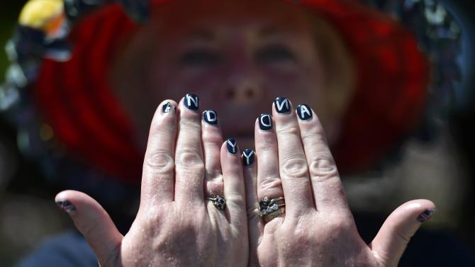 Andy Murray fan, Joan MacGillivray from Inverness shows off her fingernails on Murray Mound at the Wimbledon Tennis Championships in London