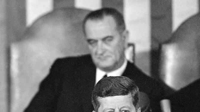 FILE - In this Jan. 14, 1963 file photo, President John F. Kennedy speaks in the House Chamber on Capitol Hill in Washington during his State of the Union report to a joint session of Congress with Vice President Lyndon Johnson sitting behind him. Kennedy's civil rights legacy has undergone substantial reassessment since his Nov. 22, 1963, assassination. His successor, President Johnson, receives credit for hammering through the monumental Civil Rights Act and Voting Rights Act, which ensured full citizenship for African-Americans. (AP Photo/File)