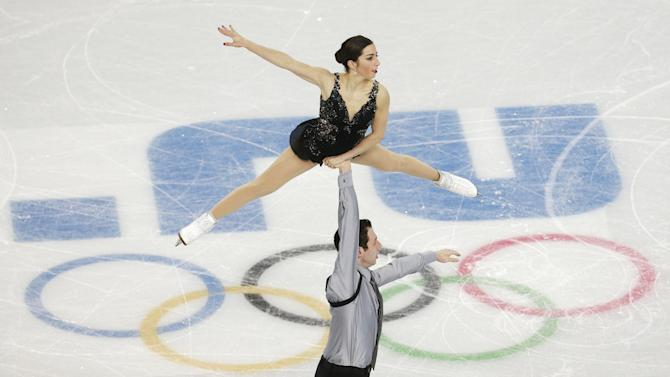 Marissa Castelli and Simon Shnapir of the United States compete in the team pairs free skate figure skating competition at the Iceberg Skating Palace during the 2014 Winter Olympics, Saturday, Feb. 8, 2014, in Sochi, Russia
