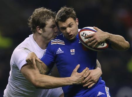 England's Launchbury tackles France's Clerc during their Six Nations rugby match at Twickenham stadium in London